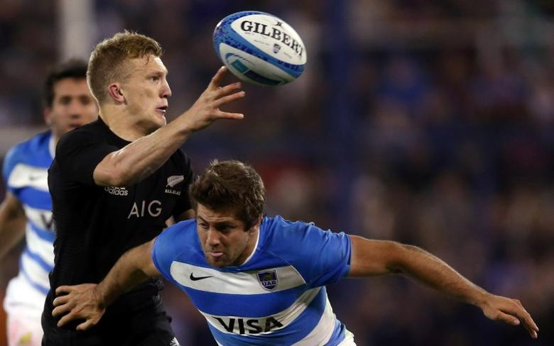 FILE PHOTO: Argentina Rugby Union - Rugby Championship - Argentina v New Zealand All Blacks - Jose Amalfitani stadium, Buenos Aires, Argentina - 01/10/2016. New Zealand's All Blacks Damian McKenzie is challenged by Argentina's Santiago Cordero. REUTERS/Marcos Brindicci