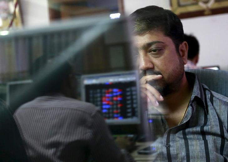 A broker reacts while trading at his computer terminal at a stock brokerage firm in Mumbai, India, August 24, 2015. REUTERS/Danish Siddiqui/Files