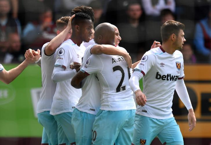 Britain Football Soccer - Burnley v West Ham United - Premier League - Turf Moor - 21/5/17 West Ham United's Sofiane Feghouli celebrates scoring their first goal with Andre Ayew and team mates Reuters / Anthony Devlin/ Livepic/ Files