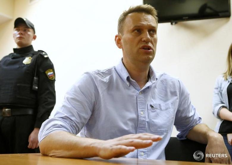 Russian opposition leader Alexei Navalny talks to journalists during a hearing at a court in Moscow, Russia, June 12, 2017. REUTERS/Sergei Karpukhin