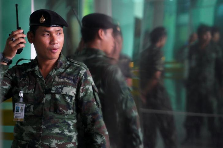 A Thai soldier stands guard near the area of the bomb blast at Phramongkutklao Hospital in Bangkok, Thailand, May 22, 2017. REUTERS/Athit Perawongmetha