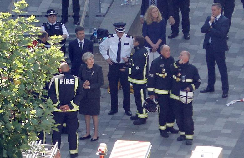 Britain's Prime Minister, Theresa May, visits the scene of a tower block which was destroyed in a fire disaster, in north Kensington, West London, Britain June 15, 2017. REUTERS/Peter Nicholls