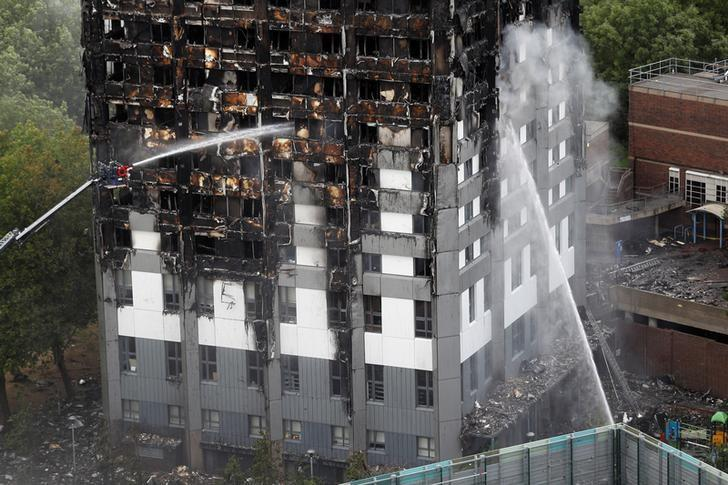 Water continues to be sprayed onto the tower block that was destroyed in a fire disaster, in north Kensington, West London, Britain June 15, 2017. REUTERS/Peter Nicholls