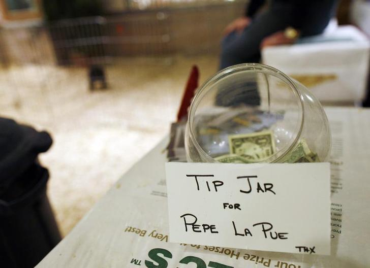 A tip jar is seen at the Dog salon inside the Hotel Pennsylvania in New York February 6, 2009. Dogs of all breeds are gathering in New York for the 133rd Annual Westminster Kennel Club Dog Show on Monday. REUTERS/Shannon Stapleton