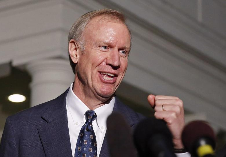 FILE PHOTO: Illinois Gov-elect Bruce Rauner talks to the media after a meeting with U.S. President Barack Obama at the White House in Washington December 5, 2014.       REUTERS/Larry Downing/File Photo