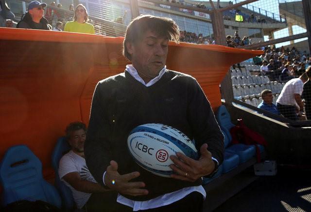 FILE PHOTO: Rugby Union - Argentina v England - San Juan del Bicentenario Stadium, San Juan, Argentina - 10/06/17 - Argentina's coach Daniel Hourcade catches a ball before the start of the match. REUTERS/Marcos Brindicci