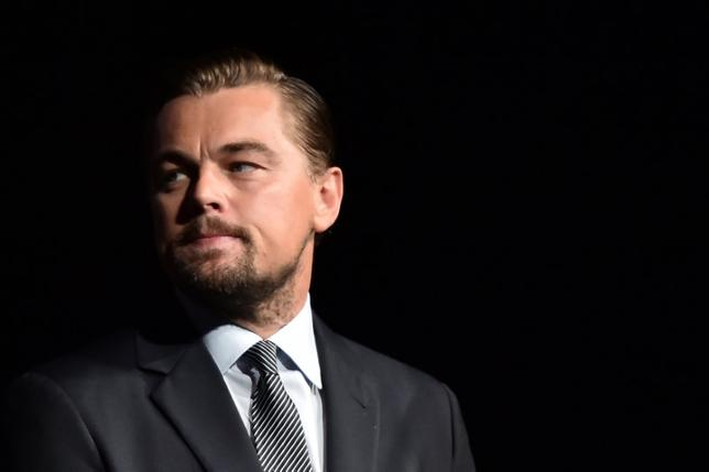 FILE PHOTO: U.S. actor Leonardo DiCaprio looks on prior to speaking on stage during the Paris premiere of the documentary film ''Before the Flood'' at the Theatre du Chatelet in Paris, France on October 17, 2016.    REUTERS/Christophe Archambault/Pool/File Photo