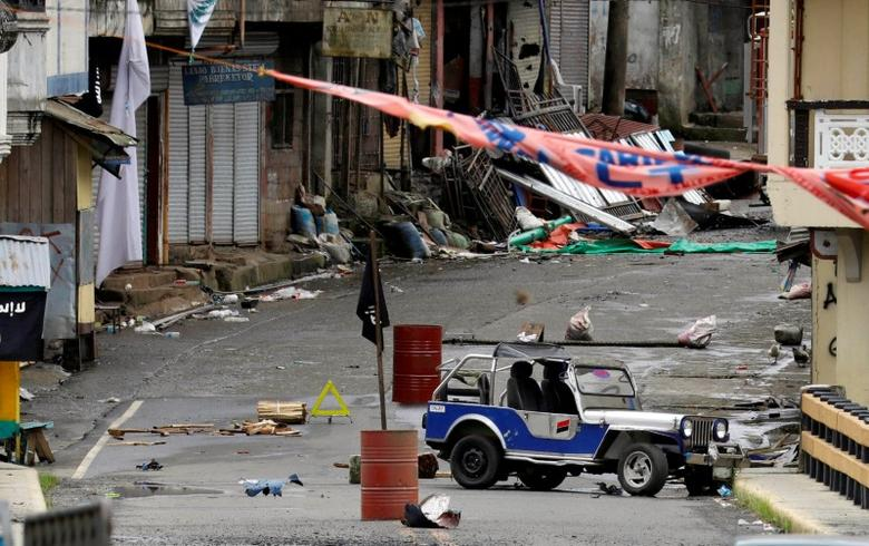 A view of the Maute group stronghold with an ISIS flag in Marawi City. REUTERS/Erik De Castro
