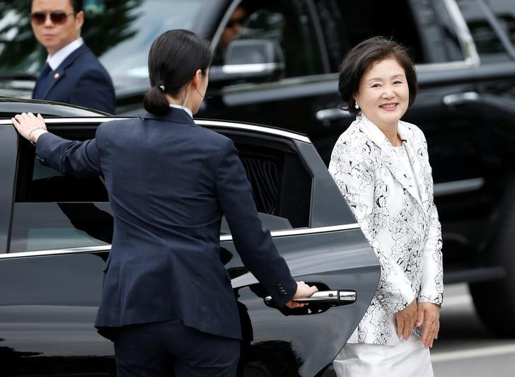 South Korea President Moon Jae-in's wife Kim Jung-sook gets out of a car to meet to neighborhood residents upon her arrival at the presidential Blue House in Seoul, South Korea May 10, 2017. REUTERS/Kim Kyung-Hoon