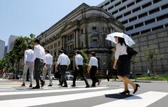 People walk past the Bank of Japan building in Tokyo, Japan June 16, 2017.   REUTERS/Toru Hanai