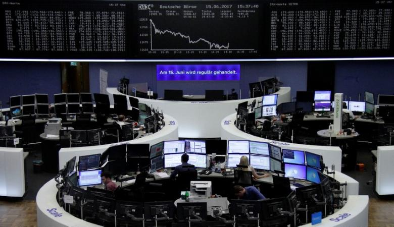 Traders work in front of the German share price index, DAX board, at the stock exchange in Frankfurt, Germany, June 15, 2017. REUTERS/Staff/Remote