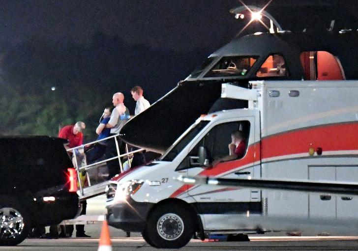 A person believed to be Otto Warmbier is transferred from a medical transport airplane to an awaiting ambulance at Lunken Airport in Cincinnati, Ohio, U.S., June 13, 2017.  REUTERS/Bryan Woolston
