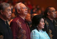 FILE PHOTO: Malaysia's Prime Minister Najib Razak and wife Rosmah Mansor arrives before Najib's National Day speech in the capital city of Kuala Lumpur August 30, 2015.   REUTERS/Edgar Su/File Photo