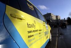FILE PHOTO: A taxi with the Taxify logo waits for a passenger in Riga, Latvia, January 15, 2015.  REUTERS/Ints Kalnins/File Photo