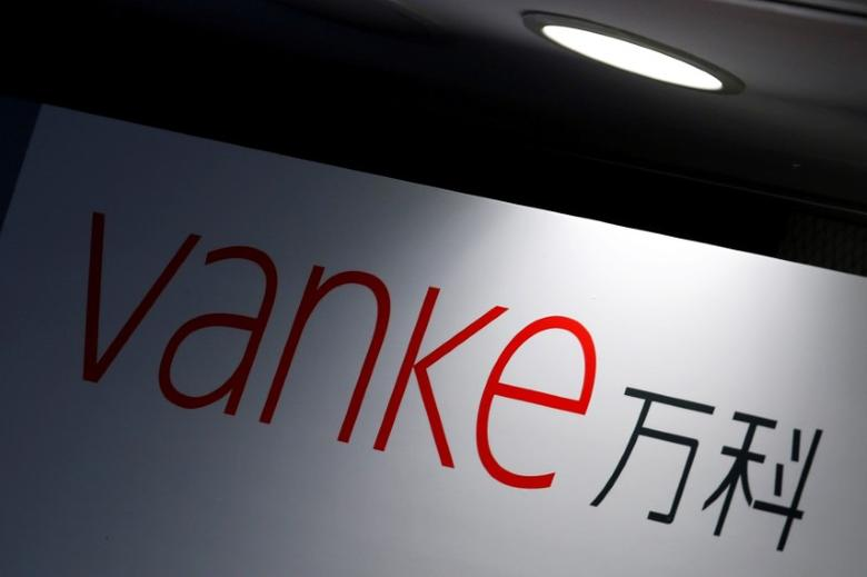 FILE PHOTO: The company logo of China Vanke is displayed at a news conference announcing the property developer's interim results in Hong Kong, China August 22, 2016.  REUTERS/Bobby Yip/File Photo