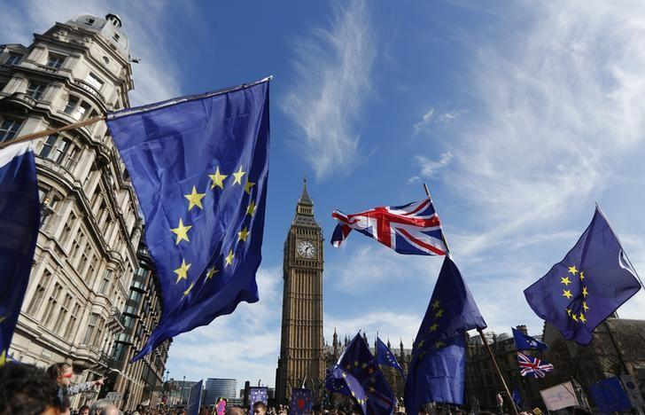 FILE PHOTO - EU and Union flags fly above Parliament Square during a Unite for Europe march, in central London, Britain March 25, 2017.    REUTERS/Peter Nicholls