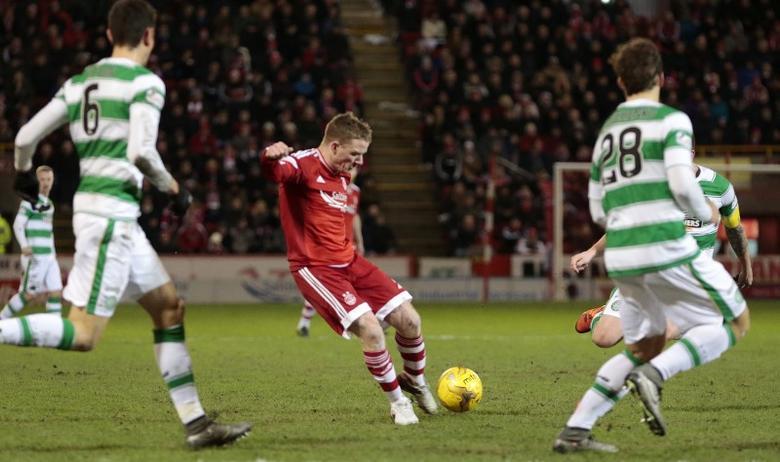 FILE PHOTO: Football Soccer - Aberdeen v Celtic - Ladbrokes Scottish Premiership - Pittodrie Stadium - 3/2/16 Aberdeen's Jonny Hayes (C) scores their first goal. Action Images via Reuters / Graham Stuart. Livepic
