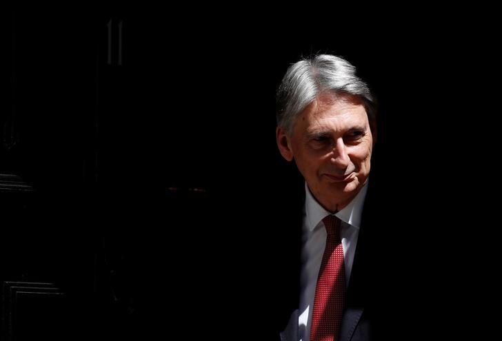 Philip Hammond, Britain's Chancellor of the Exchequer, waits to greet Party Secretary of China, Hu Chunhua, outside 11 Downing Street, in central London, Britain June 14, 2017.  REUTERS/Stefan Wermuth