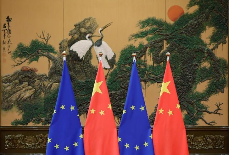 FILE PHOTO: Flags of European Union and China are pictured during the China-EU summit at the Great Hall of the People in Beijing, China, July 12, 2016. REUTERS/Jason Lee