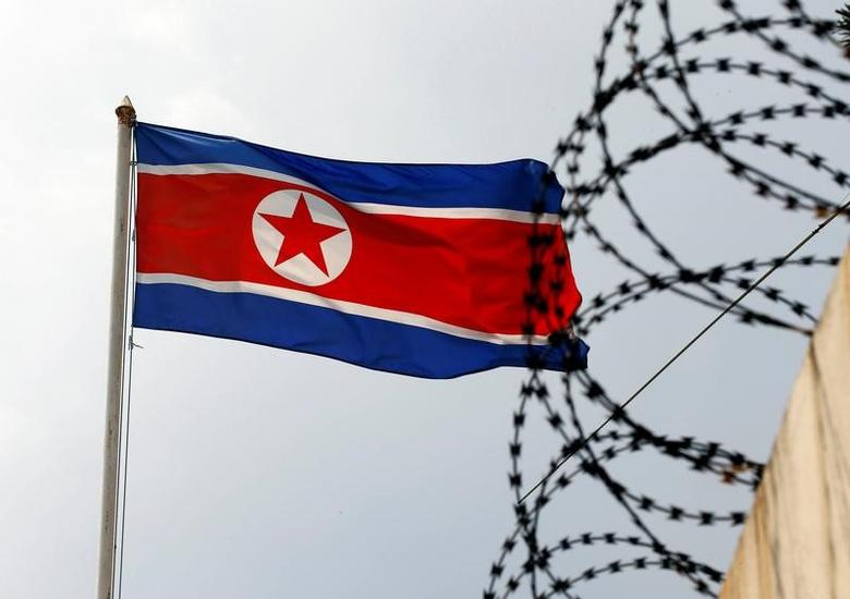 FILE PHOTO: The North Korea flag flutters next to concertina wire at the North Korean embassy in Kuala Lumpur, Malaysia March 9, 2017. REUTERS/Edgar Su