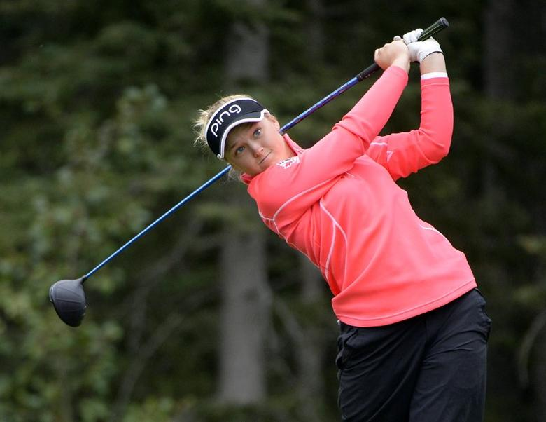 FILE PHOTO: Aug 27, 2016; Calgary, Alberta, CAN;  Brooke Henderson drives off the fourth tee box during the third round of the Canadian Pacific Women's Open at Priddis Greens Golf and Country Club. Mandatory Credit: Eric Bolte-USA TODAY Sports  / Reuters Picture Supplied by Action Images
