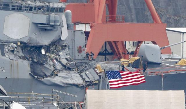 The Arleigh Burke-class guided-missile destroyer USS Fitzgerald, damaged by colliding with a Philippine-flagged merchant vessel, is seen at the U.S. naval base in Yokosuka, Japan, in this photo taken by Kyodo June 18, 2017.  Mandatory credit Kyodo/via REUTERS