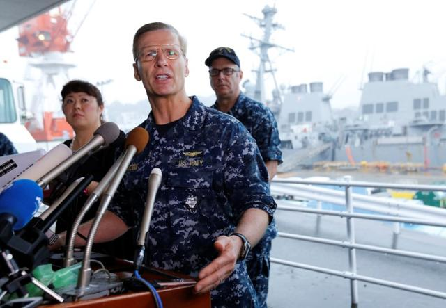 Vice Admiral Joseph Aucoin, U.S. 7th Fleet Commander, speaks to media on the status of the U.S. Navy destroyer USS Fitzgerald (seen behind him), damaged by colliding with a Philippine-flagged merchant vessel, and the seven missing Fitzgerald crew members, at the U.S. naval base in Yokosuka, south of Tokyo, Japan June 18, 2017. REUTERS/Toru Hanai