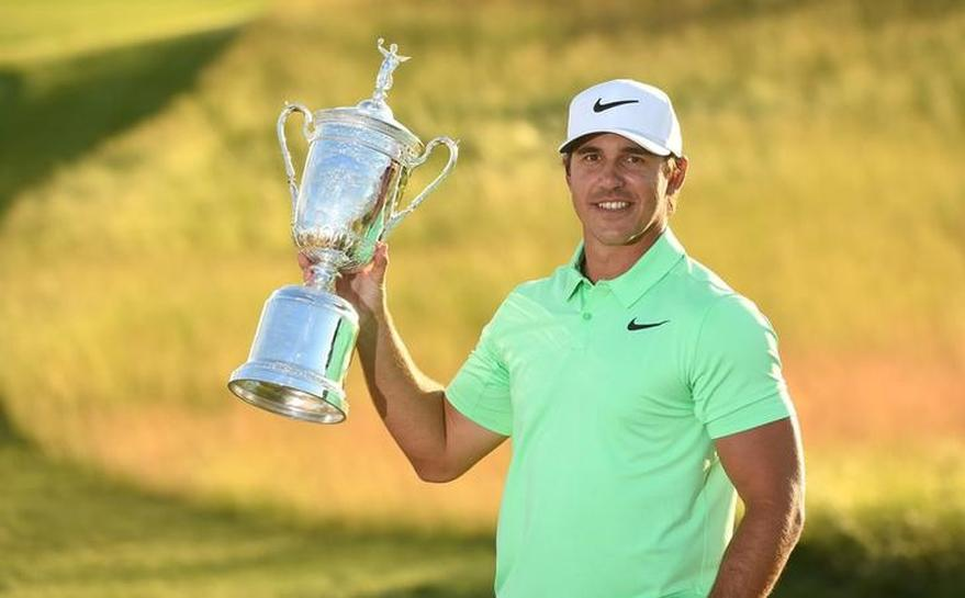 Golf: Koepka tames wind, nerves to win U.S. Open by four shots