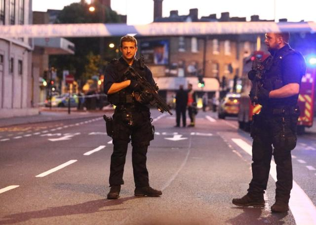 Armed police officers attend to the scene after a vehicle collided with pedestrians near a mosque in the Finsbury Park neighborhood of North London, Britain June 19, 2017. REUTERS/Neil Hall