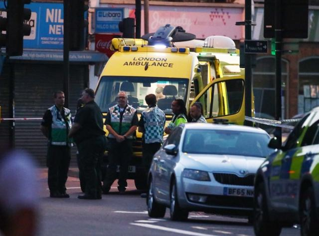 Emergency crews attend to the scene after a vehicle collided with pedestrians near a mosque in the Finsbury Park neighborhood of North London, Britain June 19, 2017. REUTERS/Neil Hall