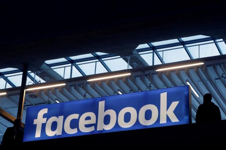 FILE PHOTO: Facebook logo is seen  at a start-up companies gathering at Paris' Station F in Paris, France, January 17, 2017. REUTERS/Philippe Wojazer/File Photo