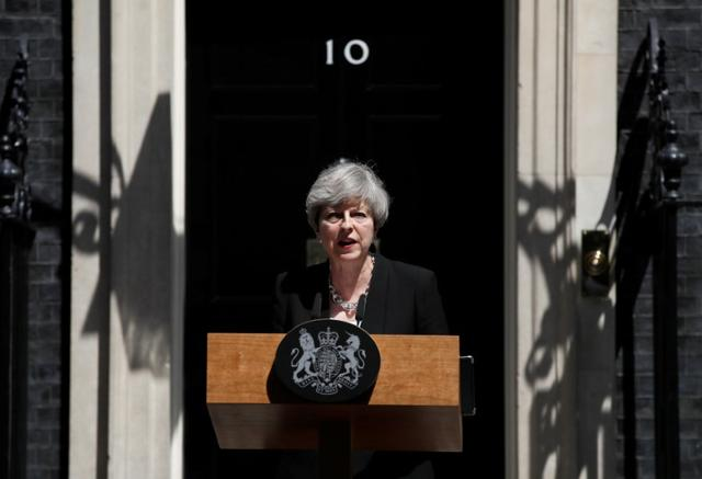 Britain's Prime Minister, Theresa May, speaks outside 10 Downing Street, following the attack at Finsury Park Mosque, in central London, Britain June 19, 2017.  REUTERS/Stefan Wermuth