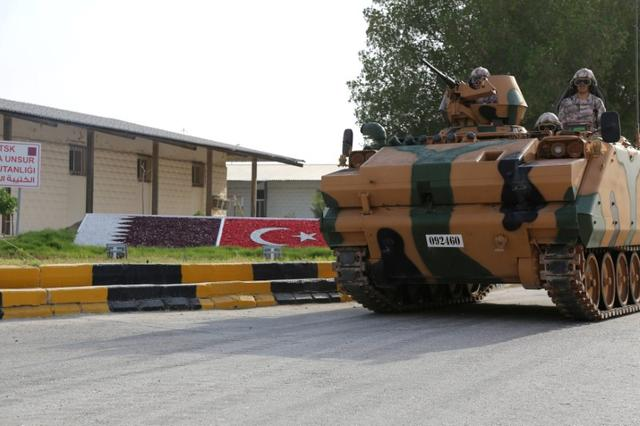 Turkish APC drives at their military base in Doha, Qatar June 18, 2017. Qatar News Agency/Handout via REUTERS
