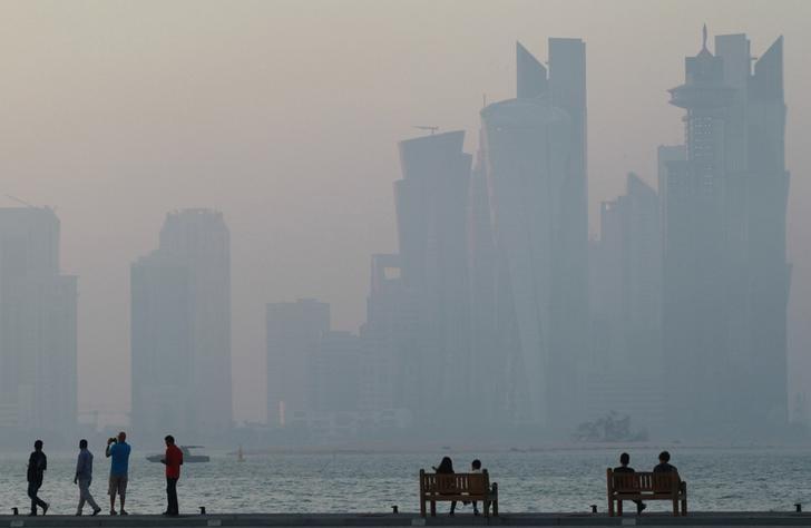 People sit on the corniche in Doha, Qatar, June 15, 2017. REUTERS/Naseem Zeitoon