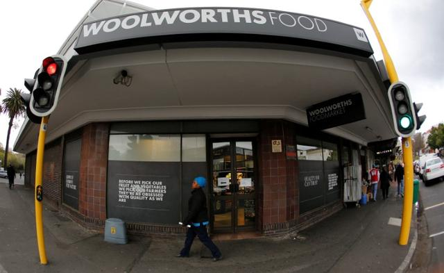 A woman walks past an outlet of retailer Woolworths in Cape Town, South Africa, June 19, 2017. REUTERS/Mike Hutchings