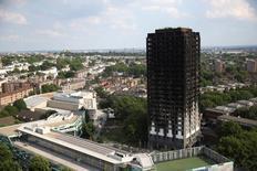 El bloque de apartamentos de la torre Grenfel en el norte de Kensington, Londres. 18 junio 2017. La cifra de muertos y desaparecidos que se presume habrían fallecido en el incendio que arrasó la semana pasada un edificio de apartamentos en la capital británica llegó a 79, informó la policía de Londres. REUTERS/Neil Hall