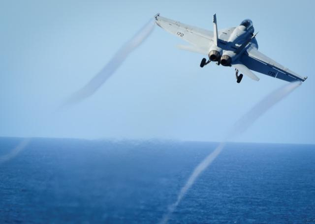 FILE PHOTO: An F/A-18E Super Hornet takes off from the flight deck of the U.S. Navy aircraft carrier USS Nimitz on October 29, 2016. U.S. Navy/Seaman Weston A. Mohr/Handout/File Photo via REUTERS