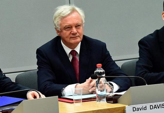 Britain's Secretary of State for Exiting the European Union David Davis and his delegation sits across from European Commission member in charge of Brexit negotiations at the start of their first day of talks at the European Commission in Brussels, Belgium, June 19, 2017. REUTERS/Emmanuel Dunand/Pool