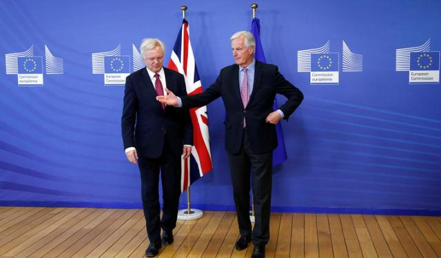 The European Union's chief Brexit negotiator Michael Barnier (R) welcomes Britain's Secretary of State for Exiting the European Union David Davis at the European Commission ahead of their first day of talks in Brussels, Belgium, June 19, 2017.    REUTERS/Francois Lenoir