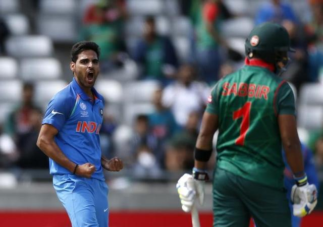 Britain Cricket - India v Bangladesh - 2017 ICC Champions Trophy Semi Final - Edgbaston - June 15, 2017 India's Bhuvneshwar Kumar celebrates taking the wicket of Bangladesh's Sabbir Rahman Action Images via Reuters / Paul Childs Livepic