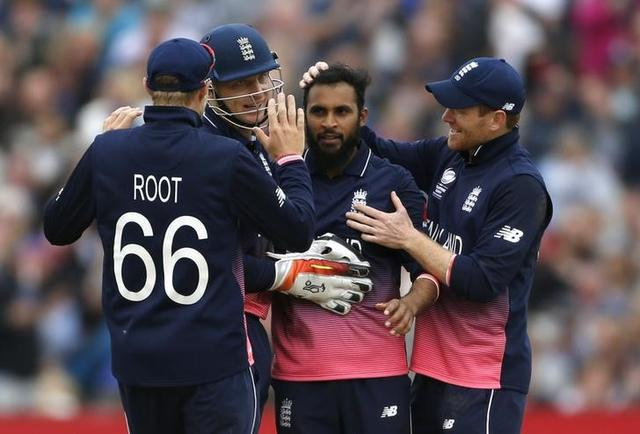 Britain Cricket - England v Australia - 2017 ICC Champions Trophy Group A - Edgbaston - June 10, 2017 England's Adil Rashid celebrates catching out Australia's Pat Cummins with teammates Action Images via Reuters / Andrew Boyers Livepic