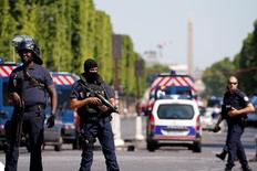 French policemen secure the area on the Champs Elysees avenue after an incident in Paris, France, June 19, 2017. REUTERS/Gonzalo Fuentes