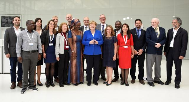 German Chancellor Angela Merkel poses for the media with participants of the Civil20 summit, which brings together civil society organisations from over 50 countries to discuss its recommendations to the G20, in Hamburg, Germany, June 19, 2017. REUTERS/Fabian Bimmer