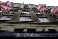 U.S. flags fly outside of Saks Fifth Avenue in New York, U.S., June 19, 2017. REUTERS/Lucas Jackson