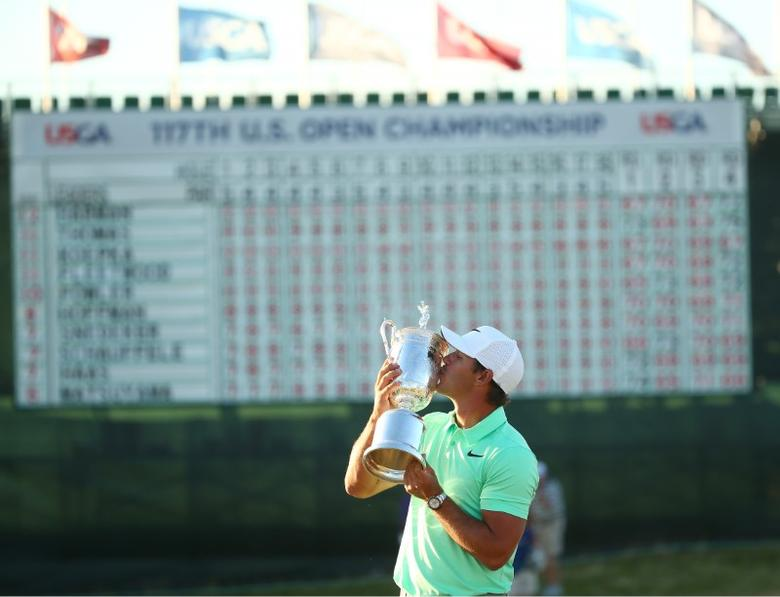 Jun 18, 2017; Erin, WI, USA; Brooks Koepka poses with the trophy after winning the U.S. Open golf tournament at Erin Hills. Mandatory Credit: Rob Schumacher-USA TODAY Sports