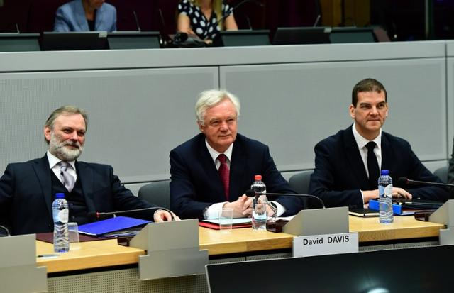 Britain's Secretary of State for Exiting the European Union David Davis (C) and his delegation sit with European Union's chief Brexit negotiator Michael Barnier (not seen) and his delegation at the start of their first day of talks at the European Commission in Brussels, Belgium, June 19, 2017. REUTERS/Emmanuel Dunand/Pool