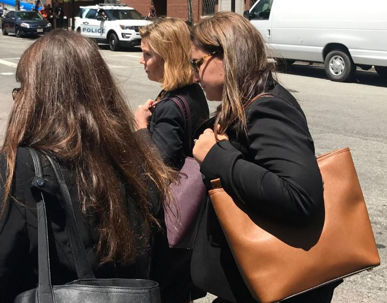 Former Insys Therapeutics Inc employee Elizabeth Gurrieri (R) leaves the federal court with members of her legal team in Boston, Massachusetts, U.S. on June 19, 2017.  REUTERS/Nate Raymond