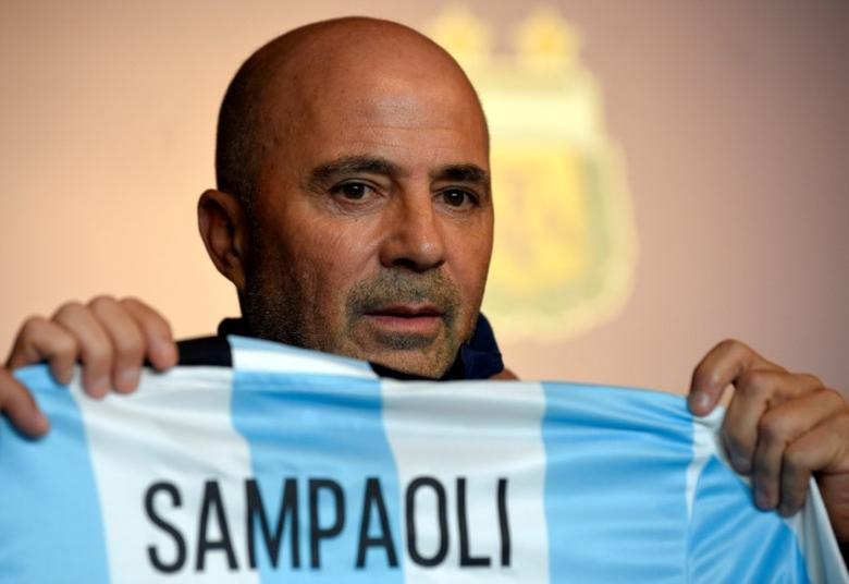 Jorge Sampaoli, newly appointed coach of Argentina's national soccer team holds a jersey with his name on it during his official presentation at the squad's camp in Buenos Aires, Argentina, June 1, 2017.  REUTERS/Gustavo Garello