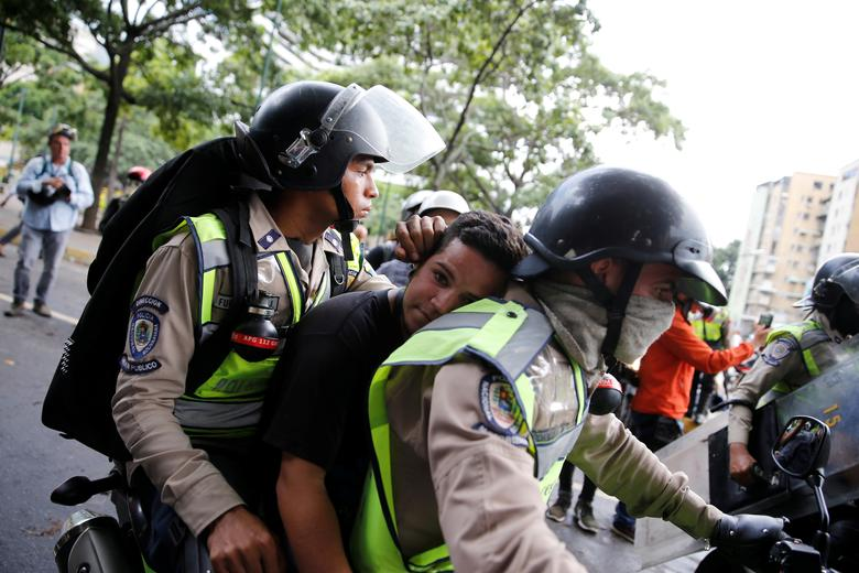 A demonstrator is detained by riot security forces during a rally against Venezuela's President Nicolas Maduro's government in Caracas, Venezuela, June 19, 2017. REUTERS/Ivan Alvarado
