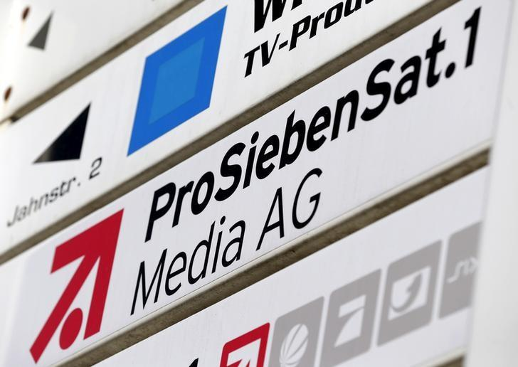 The logo of Germany's biggest commercial broadcaster ProSiebenSat.1 Media AG is pictured next to their headquarters in Unterfoehring, near Munich, Germany in this February 26, 2014 file photo. German broadcaster ProSiebenSat.1 and German publishing house Axel Springer are in early-stage merger talks, a source familiar with the matter said on July 6, 2015.     REUTERS/Michaela Rehle